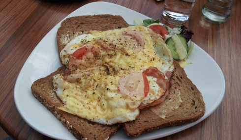 brown bread with backed egg bacon and tomato