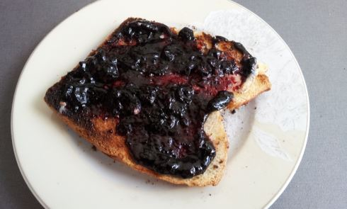 German bread with butter and blueberry jam