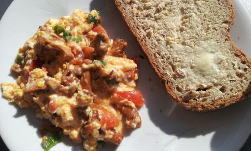 scrambled eggs with chanterelle chives and tomato